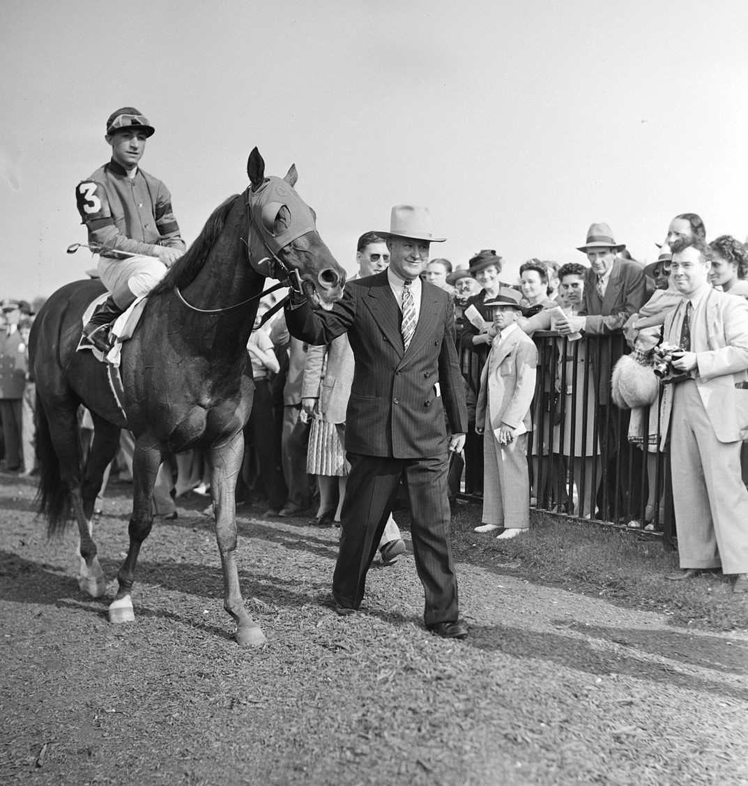 Eddie Arcaro on Whirlaway with Horace A. Jimmy Jones after winning the Belmont Stakes